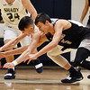 Shady Spring's (4) and Westside's (5) dive for a loose ball during their basketball game Tuesday in Shady Spring. (Chris Jackson/The Register-Herald)