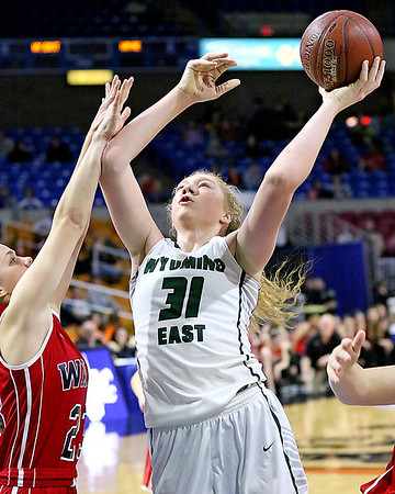 (Brad Davis/The Register-Herald) Wyoming East's Emily Saunders scores as Wayne's Maddie Wilcox defends Friday morning at the Charleston Civic Center.