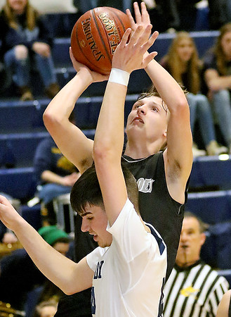 (Brad Davis/The Register-Herald) Westside's Isaiah lester drives to the basket as Shady Spring's Ryan Riffe defends Wednesday night in Shady Spring.