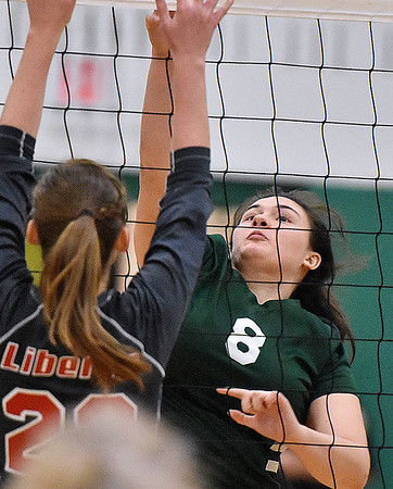 (Brad Davis/The Register-Herald) Fayetteville's Cassidy Roles leaps to tap the ball back over as Liberty's Madison Maynard tries to block it Wednesday night in Fayetteville.