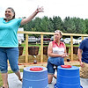 "(Brad Davis/The Register-Herald) Canvas resident Phyllis Elrod, left, reacts after winning the grape eating contest as fellow competitors (from left) Val ""The Grape"" Homa and Silas Blake are still chewing at the Kirkwood Wine Festival Sunday afternoon in Summersville."