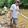 (Brad Davis/The Register-Herald) Volunteer Brian Lemon hauls PVC piping and jagged steel while he and a team of creek hikers consisting of members of Active Southern West Virginia and the Coal River Mountain Watch haul garbage pulled from a section of the Peach Tree Creek and falls areas during a cleanup effort Saturday afternoon near Naoma.