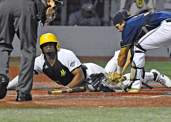 (Brad Davis/The Register-Herald) Miners baserunner Mason Washington looks up to see the umpire's out call as he's forced out at the plate with the bases loaded during the 6th inning against Lafayette Friday night at Linda K. Epling Stadium.