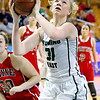 (Brad Davis/The Register-Herald) Wyoming East's Emily Saunders scores before Wayne's Sara Hooks can get to her Friday morning at the Charleston Civic Center.