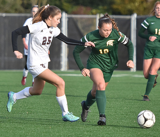(Brad Davis/The Register-Herald) Greenbrier East's Abbie Bartenslager is pressured by George Washington's Antoinette Yoakum Thursday evening at the YMCA Paul Cline Memorial Sports Complex.