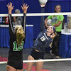 (Brad Davis/The Register-Herald) Nicholas County's Maggie Gadomski spikes the ball as Winfield's Kendall Hill tries to block it during State Volleyball Tournament action Friday afternoon at the Charleston Civic Center.