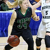 (Brad Davis/The Register-Herald) Wyoming East's Kelsey Green drives around North Marion's Taylor Buonamici Saturday afternoon at the Charleston Civic Center.