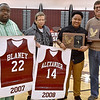 (Brad Davis/The Register-Herald) Former Woodrow Wilson girls basketball player Camisha Alexander, 2nd from right, poses for a quick photo with former head coach Bernie Bostick, right, and assistants Chuckie Diggs, far left, and Timmie Korczyk as she's inducted into the girls basketball Hall of Fame along with Ashley Blaney, who was unable to attend, during halftime of the Lady Eagles' home game against Independence Friday night.