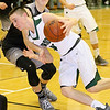 (Brad Davis/The Register-Herald) Wyoming East's Caden Lookabill drives around Westside defender Jacob Ellis Saturday night in New Richmond.