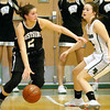 (Brad Davis/The Register-Herald) Westside's Leslie Bailey cuts right in search of a lane as Wyoming East's Kaytlin Daniels defends Thursday night in New Richmond.