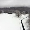 Snow blankets the fields near Muddy Creek Mountain Monday morning. (Jenny Harnish/The Register-Herald)