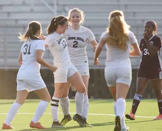 Oak Hill's Courtney Smith (12) celebrates a goal before halftime with her team during their soccer match against Woodrow in Beckley on Tuesday. (Chris Jackson/The Register-Herald)