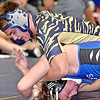 (Brad Davis/The Register-Herald) Shady Spring's Daylin Toms takes on Lewis County's Will Kuhn as the two square off in a 170-pound weight class matchup Friday night at the Summersville Arena and Convention Center. Shady's Toms would win the match.