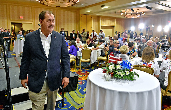 (Brad Davis/The Register-Herald) Republican U.S. Senate candidate Don Blankenship exits the stage after giving supporters an update during his results party Tuesday night at the Charlseton Marriott.