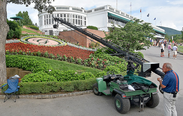 (Brad Davis/The Register-Herald) A member of the NBC broadcast crew uses a crane cam to get those fancy, progressive landscape shots frequently seen on TV during opening round action of the Military Tribute at The Greenbrier Thursday afternoon in White Sulphur Springs.