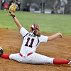 (Brad Davis/The Register-Herald) Independence 1st baseman Ashleigh Sexton shows her flexibility as she does a full split to make a catch against Wyoming East Friday evening at Liberty High School.