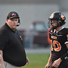 Summers County coach Chris Vicars  with quarterback Timmy Persiani (10) during their high school football game against Shady Spring Friday in Hinton. (Chris Jackson/The Register-Herald)