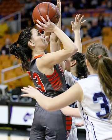(Brad Davis/The Register-Herald) Summers County's Hannah Taylor drives and scores against Parkersburg Catholic Thursday night at the Charleston Civic Center.