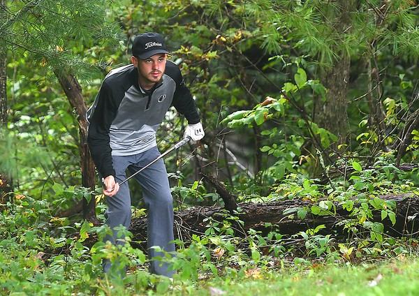 Caleb Cook, of Westside, looks over his third shot in a wooded area behind the par 4, 16th green during the Class AA Region 3 golf tournament held at Grandview Country Club in Beaver.<br /> (Rick Barbero/The Register-Herald)