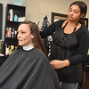 (Brad Davis/The Register-Herald) Customer Brittany Farrell gets her first haircut in two years from Get Faded & Dye stylist Tyjhea Grandjean Wednesday afternoon.