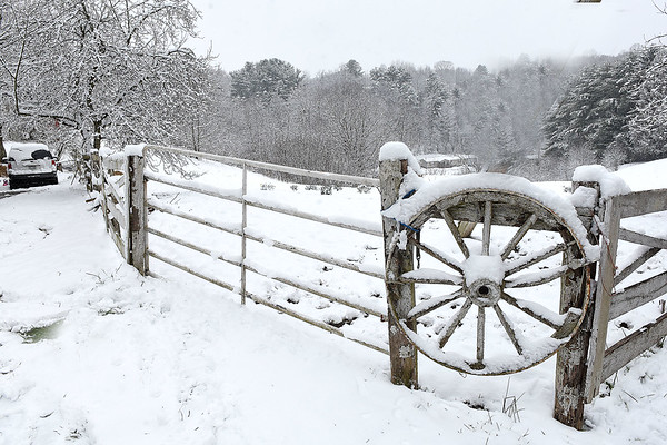 Snow covered the trees and fence off of Old Eccles Road in Beckley after the area got hit with 4 inches of snow early monday morning.<br /> (Rick Barbero/The Register-Herald)