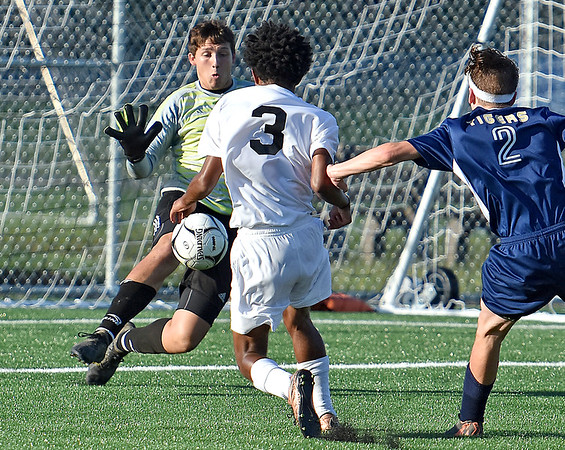 (Brad Davis/The Register-Herald) Shady Spring goalkeep Erick Bevil steps up to thwart a close-range scoring change from Bluefield's Jaylin Harris Thursday evening at the YMCA Paul Cline Memorial Sports Complex.