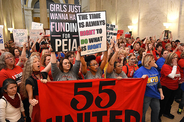 Teachers, service personnel and students, rally in front of the Senate Chambers in the State Capitol during the seventh day of their walkout. <br /> (Rick Barbero/The Register-Herald)