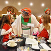 "Mrs. Claus meets with Emily Murphy, 8, and Mandy Fotos, 4, and Eli Fotos, 7, during ""Tea with Santa"" as part of the Santa Christmas Adventure at The Resort at Glade Springs on Saturday. (Chris Jackson/The Register-Herald)"