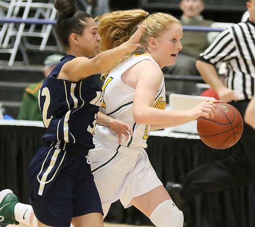(Brad Davis/The Register-Herald) Greenbrier East's Kate Perkins drives across mid-court under pressure from Hedgesville's Malie Guest during Big Atlantic Classic action Thursday night at the Beckley-Raleigh County Convention Center.