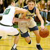 (Brad Davis/The Register-Herald) Shady Spring's Tommy Williams drives into the lane as Wyoming East's Zach Brown defends Friday night in New Richmond.