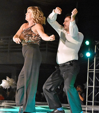 (Brad Davis/The Register-Herald) Dancers Christi Short and Gerald Hayden perform during the United Way of Southern West Virginia's Dancing With the Stars fundraising event Friday night at the Beckley-Raleigh County Convention Center.