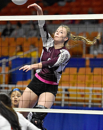 (Brad Davis/The Register-Herald) Woodrow Wilson's Bryce Knapp spikes the ball against University during State Volleyball Tournament action Friday evening at the Charleston Civic Center.