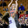 (Brad Davis/The Register-Herald) Summers County's Tiffani Cline drives and scores as St. Joseph Central's McKenzie Moran defends Friday night at the Charleston Civic Center.
