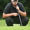 Dawson Browning, of Westside, studies his putt on the par 3, 11 hole during the Class AA Region 3 golf tournament held at Grandview Country Club in Beaver.<br /> (Rick Barbero/The Register-Herald)