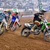 (Brad Davis/The Register-Herald) Racers pour into a turn during the opening lap of a 450B, 18 and up divison race during the weekend's Tristate MX dirt bike racing event Saturday night at the Beckley-Raleigh County Convention Center.