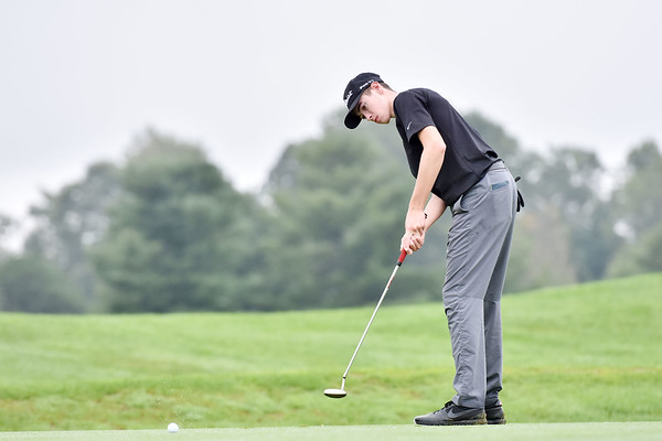 Woodrow Wilson's Jackson Hill watches his putt on the No. 8 green during their Class AAA, Region 3 golf tournament at Pipestem Resort State Park on Monday. (Chris Jackson/The Register-Herald)