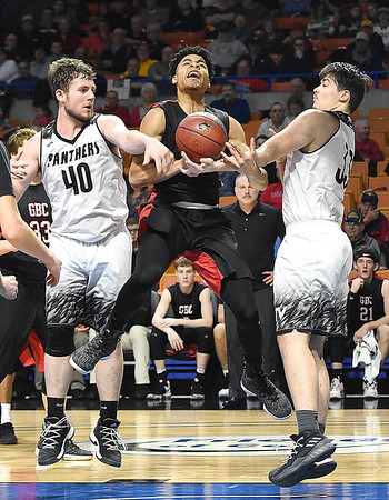 Jat Moore, of Greater Beckley Christian, center, struggles for a rebound against, Mason Lane and Colby Savage, of Tug Valley, during the quarter-final game of the Class A Boys State Basketball Tournament held at the Charleston Civic Center. Tug Valley won 83-52<br /> (Rick Barbero/The Register-Herald)