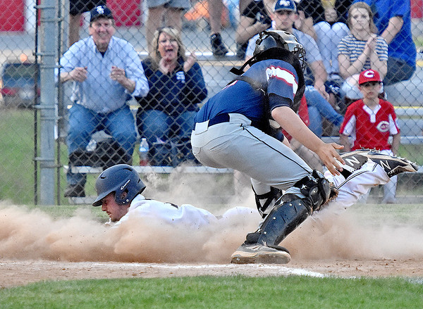 (Brad Davis/The Register-Herald) Shady Spring's Kenneth Sizemore dives home to beat Bluefield catcher Drake Mullins' tag and score a run off a squeeze play Wednesday evening in Shady Spring.