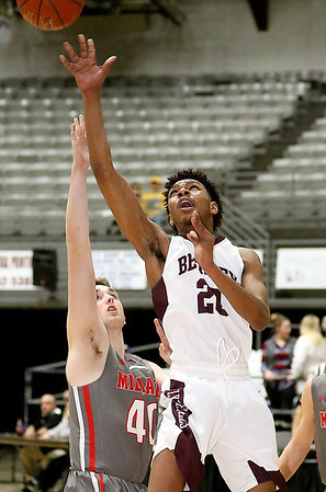 (Brad Davis/The Register-Herald) Woodrow Wilson's Mikey Penn drives and scores as Cabell Midland's Ty Haynes defends Wednesday night at the Beckley-Raleigh County Convention Center.