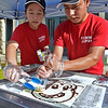 (Brad Davis/The Register-Herald) Yummi Japan employees Christina Zheng and Syracuse Victor run one of the more interesting booths to watch as they make Thai Roll Ice Cream during Taste of Beckley Saturday evening.