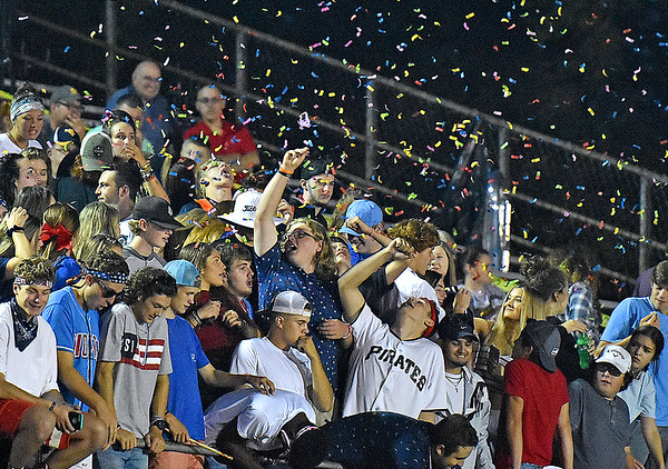 (Brad Davis/The Register-Herald) Rowdy Greenbrier East students launch confetti Friday night in Fairlea.