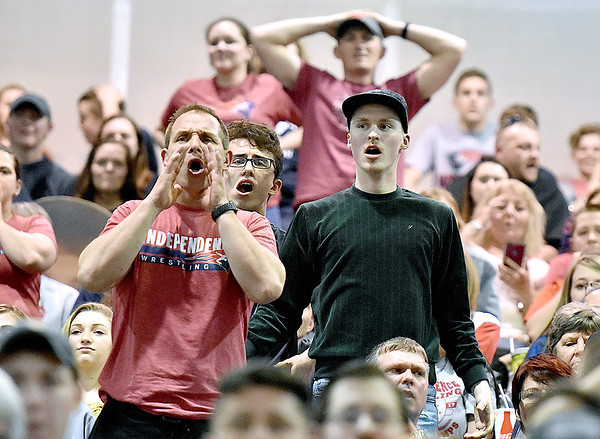 (Brad Davis/The Register-Herald) Independence fans and family react negatively to events on the mat during State Wrestling Tournament action Saturday night at the Big Sandy Arena.