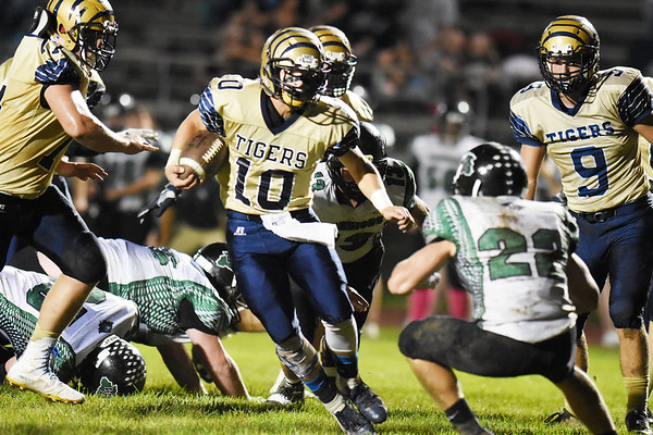 Shady Spring's Drew Clark (10) looks to get past Wyoming East's Caleb Bower (22) during their high school football game Friday in Shady Spring. (Chris Jackson/The Register-Herald)