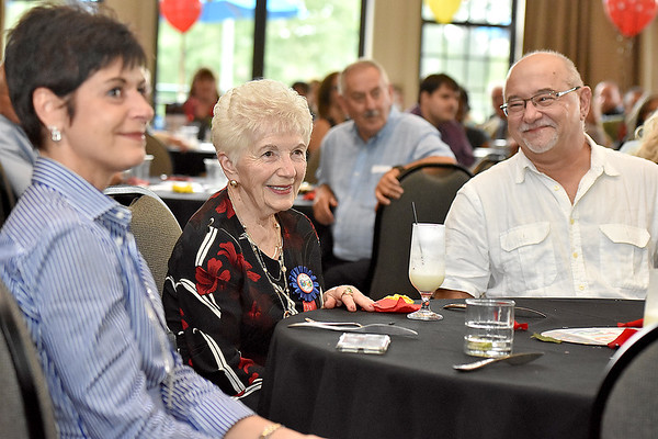(Brad Davis/The Register-Herald) Longtime, retiring Plaza McDonald's employee Jessie Wolfe, middle, watches video messages from friends who couldn't attend flanked by children Barbara Sharer and Bill Florek September 19 at Black Knight.
