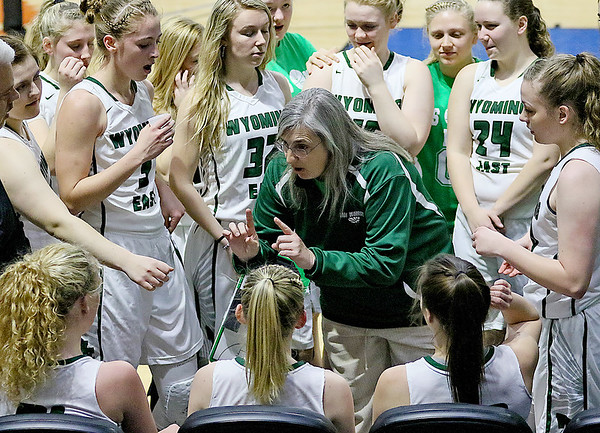 (Brad Davis/The Register-Herald) Wyoming East coach Angie Boninsegna instructs her team during a timeout Friday morning at the Charleston Civic Center.