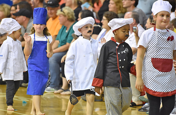 """(Brad Davis/The Register-Herald) A gaggle of chefs waves to the crowd as they and fellow young actors sing and dance through scenes of their special end of summer play called """"Campo di Bambini,"""" an Italian-themed show to cap off St. Francis de Sales Catholic School's annual summer day camp Thursday evening in the school's gym."""