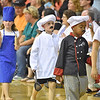 "(Brad Davis/The Register-Herald) A gaggle of chefs waves to the crowd as they and fellow young actors sing and dance through scenes of their special end of summer play called ""Campo di Bambini,"" an Italian-themed show to cap off St. Francis de Sales Catholic School's annual summer day camp Thursday evening in the school's gym."