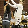 (Brad Davis/The Register-Herald) Woodrow Wilson's Liz Cadle drives to the basket as George Washington's Vivian Ho defends Thursday night in Beckley.