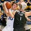 (Brad Davis/The Register-Herald) Shady Spring's Erick Bevil fights for a loose rebound with Westside's Broc Smith (#1) and Corey Hatfield (background) Wedensday night in Shady Spring.