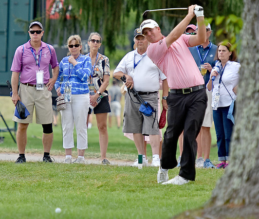 (Brad Davis/The Register-Herald) Tom Hoge's shot (seen at lower left) doesn't get very far as he struggles to get the ball out of the gallery area on 17 during the second round of the Military Tribute at The Greenbrier Thursday afternoon in White Sulphur Springs.